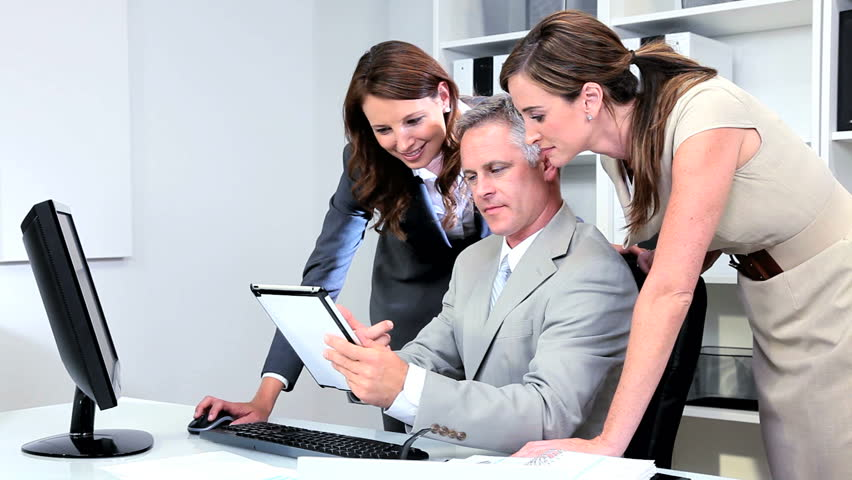 Team financial advisors pleased with current share market values | Shutterstock HD Video #2873848