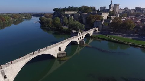 AVIGNON FRANCE NOV 2016 - DRONE SHOT OF THE HISTORICAL CENTER FROM BARTHELASSE ISLAND T UP TO SAINT-BENEZET BRIDGE TO THE POPES PALACE. FALL ATMOSPHERE IN PROVENCE.