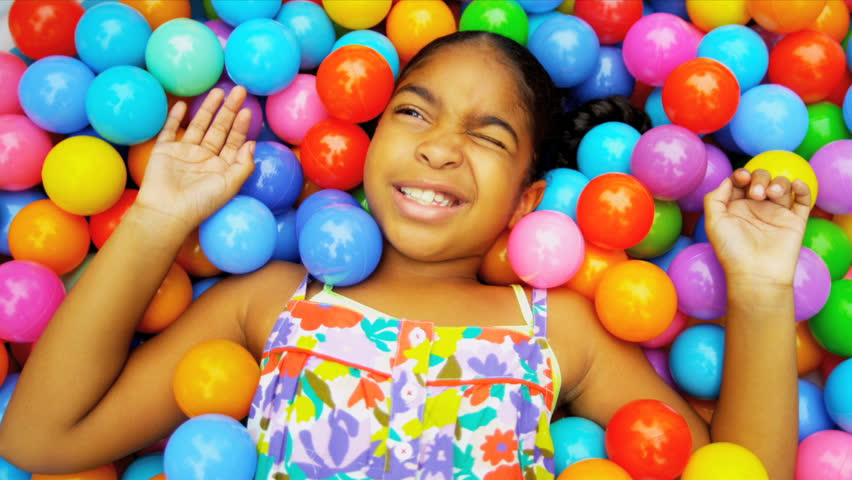 Close up African American little girl playing in ball pool shot on RED EPIC