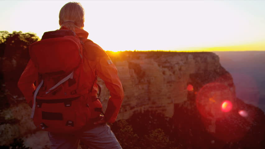Female motivated by her achievement viewing canyon sunset, Grand Canyon, USA, Shot on Red Epic