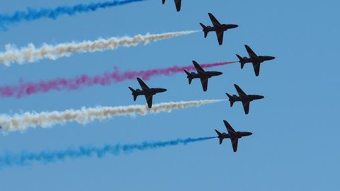 WESTON - June 17: Red Arrows Silhouettes & Colored Smoke in Sky, RAF Airshow Display on June 27th 2017 in Weston Super Mare, England