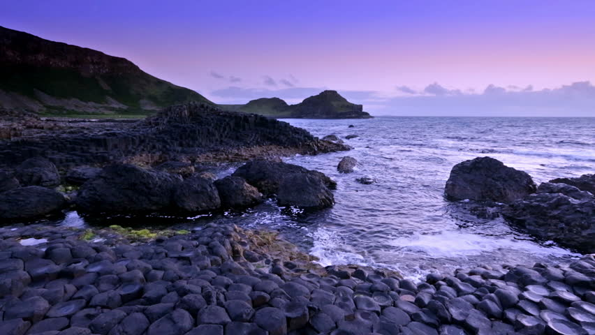 Sunset over basalt rocks formation Giant's Causeway known as UNESCO World Heritage Site, County Antrim, Northern Ireland | Shutterstock HD Video #28797388