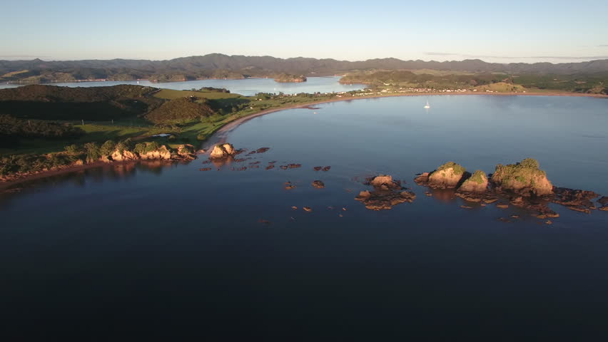 Scenic aerial shot of Bland Bay in Northland, New Zealand | Shutterstock HD Video #28808848