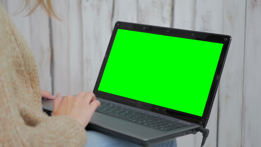 Woman using laptop with green screen. Business, communication, freelance and internet concept | Shutterstock HD Video #28809130