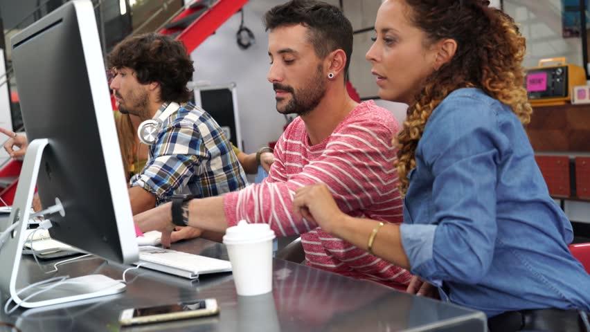 Start-up people working on desktop in co-working space | Shutterstock HD Video #28822108