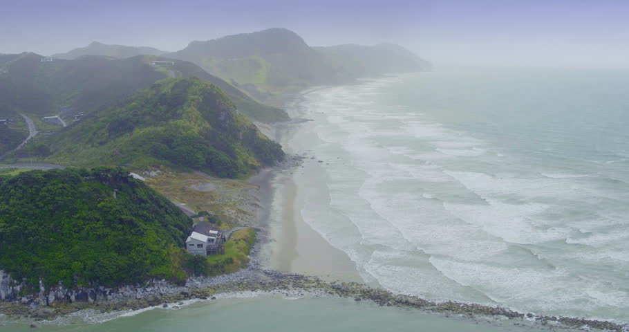 Aerial over beach in the fog at mangawhai heads, northland, new zealand | Shutterstock HD Video #28830778