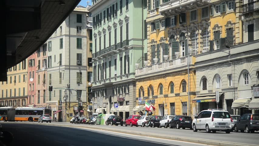 Old buildings line a busy street with vehicles and pedestrians passing through palermo italy - Arredo bagno via gramsci genova ...