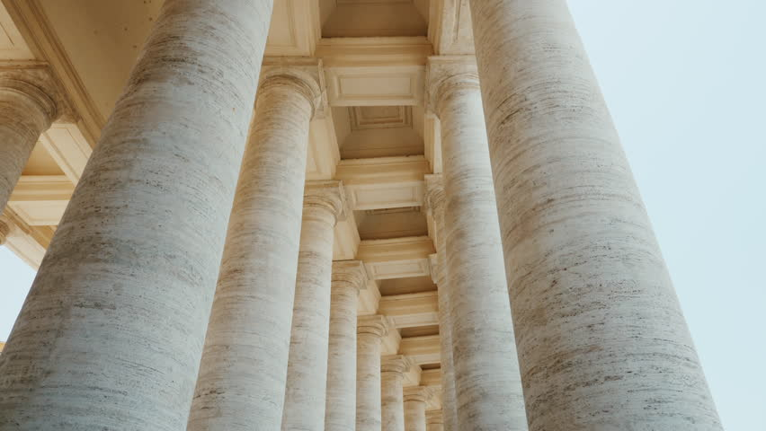 White columns of St. Peter's Church, the Vatican City. Piazza San Pietro, Rome, Italy. POV video