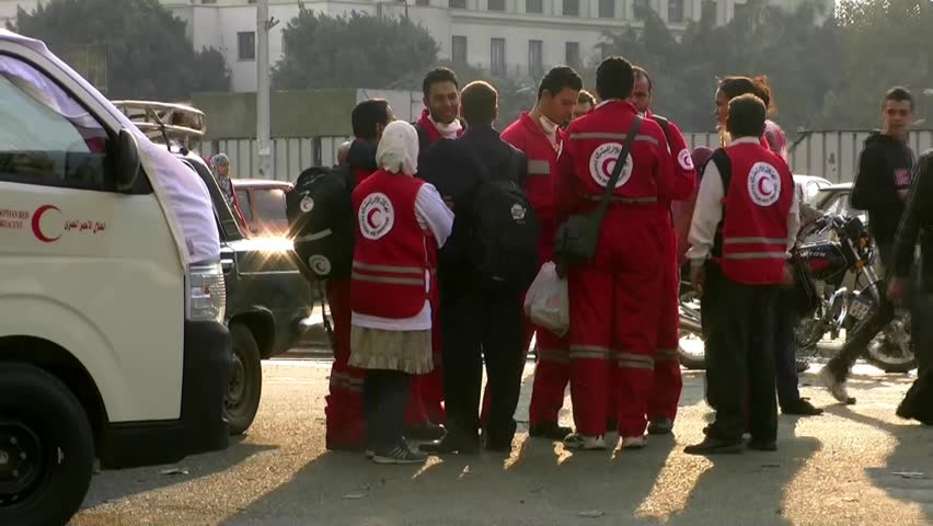 CAIRO, EGYPT – CIRCA DEC 2011: Members of the Muslim Red Cross circa December 2011 in Tahrir Square in Cairo, Egypt.