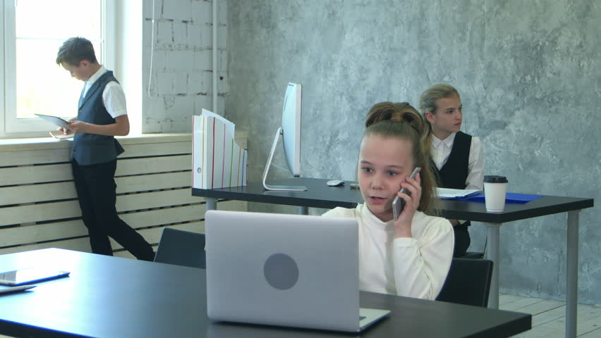 Little Office Kids Working With Documents And Laptop Computer In Office    4K Stock Video Clip