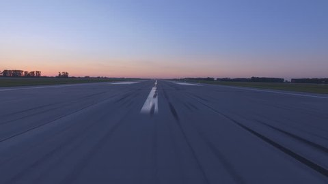 Airplane accelerates over the runway - POV 4K