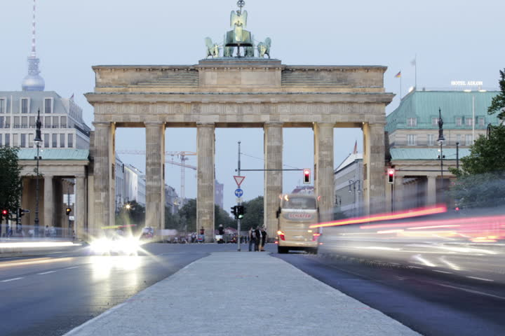 Static shot of Berlin's historical Brandenburg Gate shot over a time-lapsed 2-hour period, depicting the transition from a cloudy summer's evening to a humid dusky night.