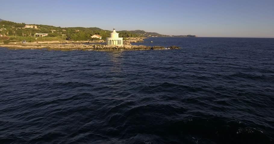 Flying toward Lighthouse Saint Theodore in Lassi;  Kefalonia island, Greece
