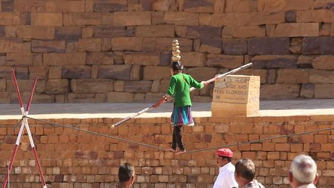 JAISALMER, INDIA - FEBRUARY 08, 2017 : Unknown equilibrist family carries out show in time Desert Festival in Jaisalmer, Rajasthan, India