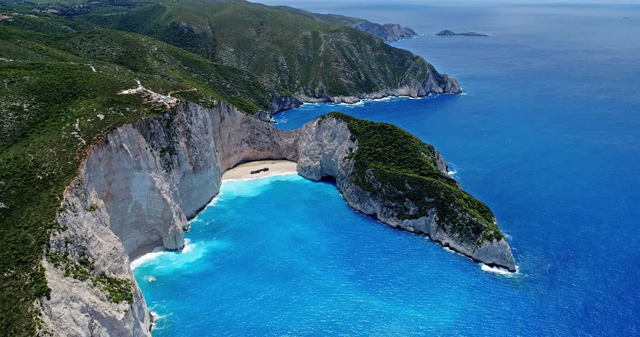 Aerial flight with drone over the Navagio (Shipwreck) Beach in Zakynthos island, Greece. Navagio Beach is a popular attraction among tourists visiting the island of Zakynthos