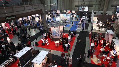MILAN, ITALY - OCTOBER 17: Panoramic view of people visiting tech exhibition area at SMAU, international fair of business intelligence and information technlogy October 17, 2012 in Milan, Italy.