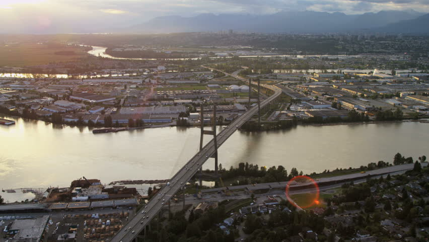 Aerial above view Fraser River Bridge cabled stayed bridge over Fraser River North Delta Vancouver BC Canada RED EPIC | Shutterstock HD Video #29009218
