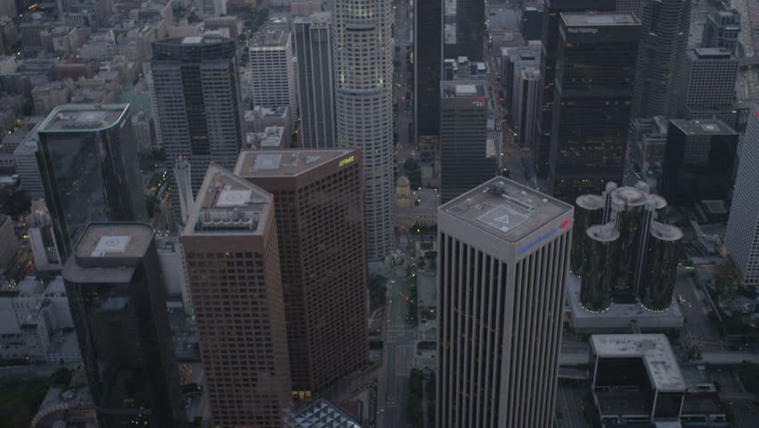 Los Angeles USA - April 2017: Aerial illuminated dusk view of downtown city skyscrapers Heli Pad California America RED EPIC | Shutterstock HD Video #29011918
