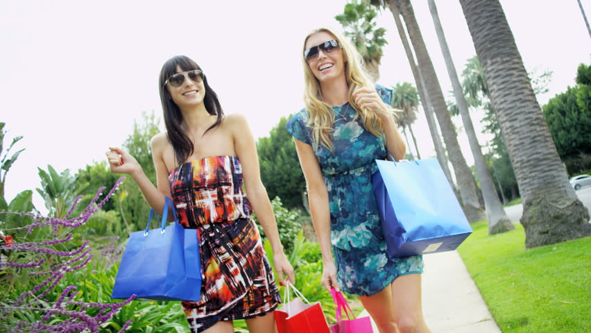 Glamorous lifestyle of young European female friends chatting in summer sun after day of retail therapy RED EPIC | Shutterstock HD Video #29014558