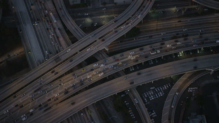 Los Angeles USA - April 2017: Aerial vertical illuminated view of traffic freeway intersections in congested commuter cities California RED EPIC | Shutterstock HD Video #29015668