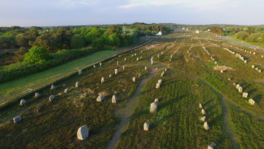 "Flying over the famous ""Alignements de Carnac"" located in Carnac, Morbihan, Brittany, France. Sunset on the Megaliths of the Menec, one of the largest Megalithic complex in the world."