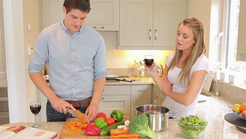Charming Man Is Cutting Vegetables With Woman Drinking Wine Then Kissing In Kitchen  Stock Footage Video 2905018 | Shutterstock