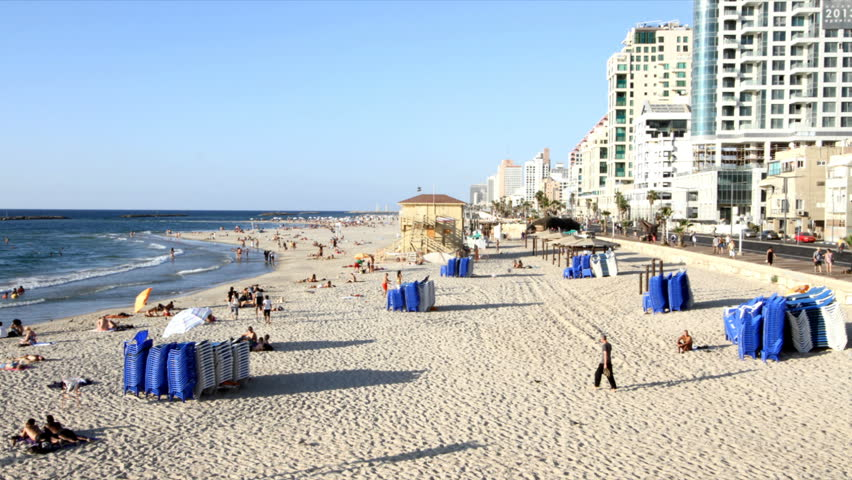 Tel-Aviv – September 26: people and recliners at the beach in stop motion in Tel-Av