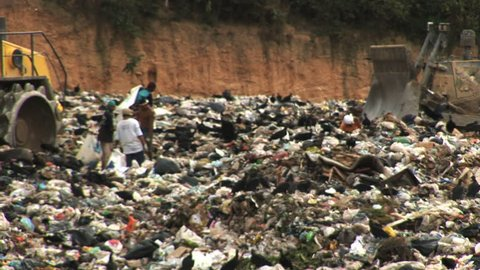 """Poor Venezuela's people searching through the landfill for food """"Poverty stricken""""Pollution."""