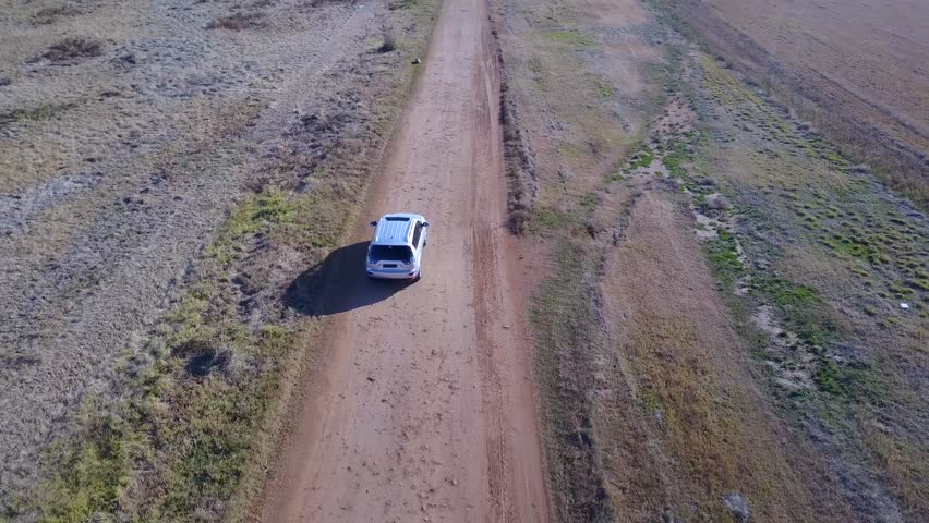 Silver family car riving on gravel road  | Shutterstock HD Video #29100358