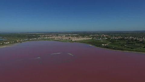 AIGUES MORTES - FRANCE 2016 - DRONE VIEW OF THE SALT LAKE ON THE SOUTH CITY SIDE