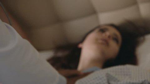 Teenage girl in a hospital, slowmotion