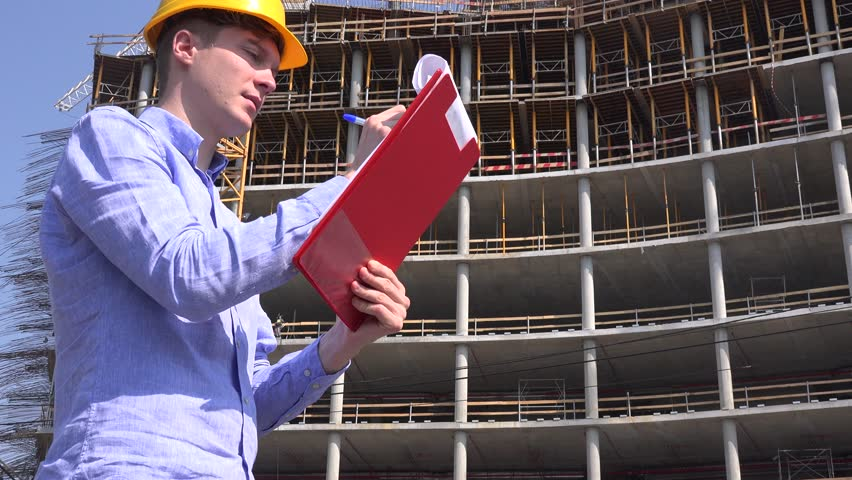 Architect profession reading blueprint construction plan builder portrait engineer construction worker writing clipboard notes smiling to camera 4k stock video clip malvernweather Image collections