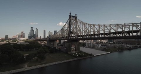 Aerial View of Queensboro Bridge, Long Island City in background, pulls away and descends