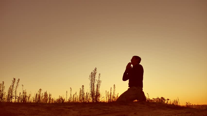 Silhouette illustration of man praying outside at beautiful landscape | Shutterstock HD Video #29170918