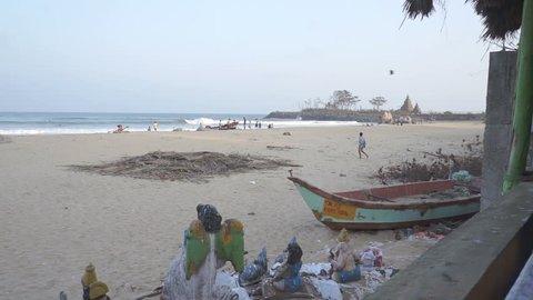Mahabalipuram, India - 02.10.2014: Statues damaged in 2004 tsunami on the  beach at Mahabalipuram