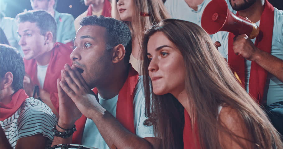 Group of fans watch a sport championship on stadium. People are dressed in casual cloth. | Shutterstock HD Video #29181148