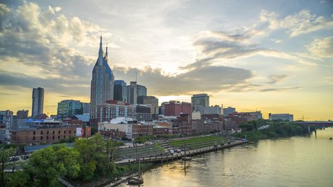 Nashville Sunset Time Lapse of Skyline 4K 1080p - Sun setting behind downtown Nashville, Tennessee and river.