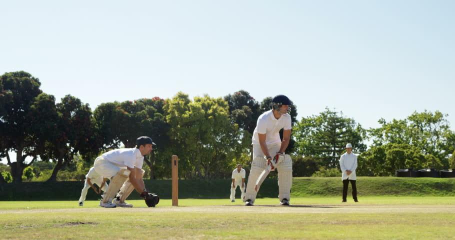 Batsman hitting a ball during match on cricket field