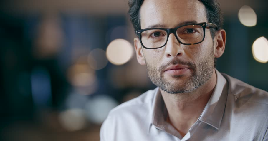 Confident man with eye glasses smiling portrait. Corporate business team work office meeting. Caucasian businessman and businesswoman people group talking together. Collaboration, growing, success. 4k video
