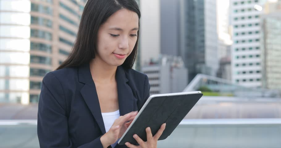 Businesswoman working on tablet computer at night    Shutterstock HD Video #29232658