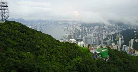Fly over nature on mountain to IFC tower, sky100 Tower Hong Kong City, Hongkong, Hong Kong 4k video aerial
