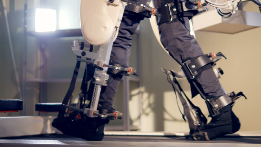 Human making steps on robotic futuristic medical device. 4K.