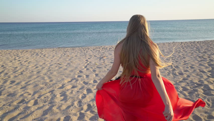 Young Blonde Girl In Long Red Dress Smiling And Waving -5540