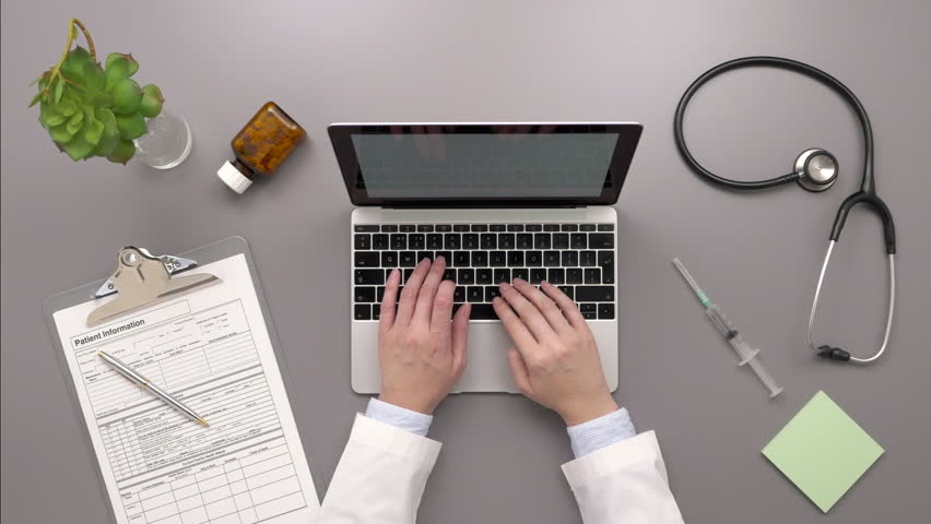 Top View Overhead Video Of Female Doctor Using Laptop At Desk | Shutterstock HD Video #29369098