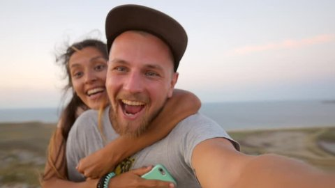 Young mixed race couple running piggyback and having fun. HD Slowmotion.