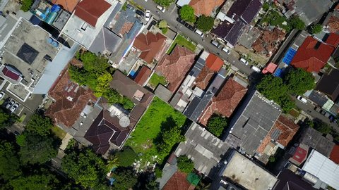 JAKARTA, INDONESIA - APRIL 2017: Overhead aerial shot of low-rise buildings, grid structure in Jakarta city, Indonesia