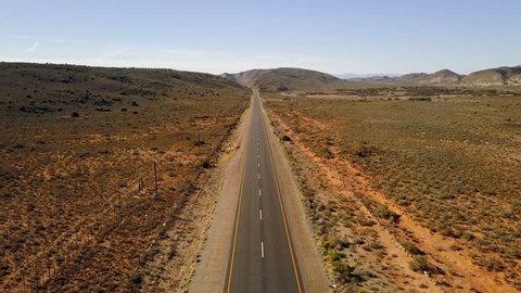 Long straight road in arid semi desert, aerial