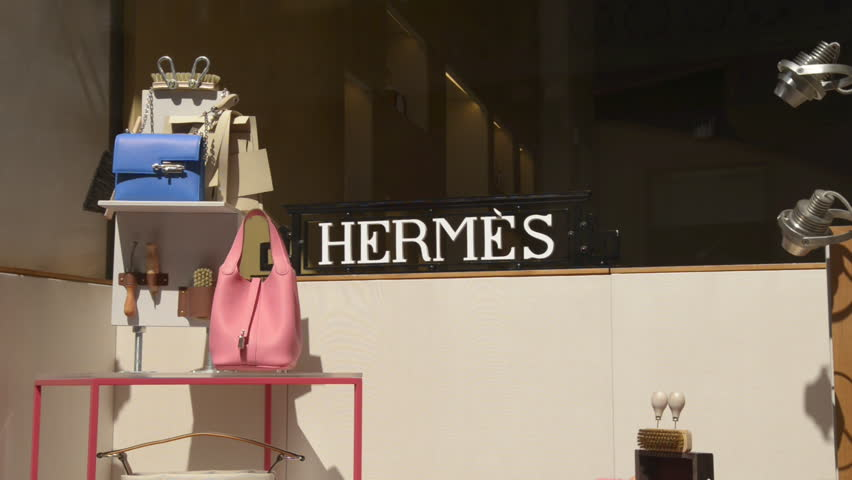 Milan, Italy - June 22, 2017: Shop window of a Hermes shop in Milan – Montenapoleone area. Milan in summer becomes a popular shopping destination for tourists. Fall Winter 2017 Collection.