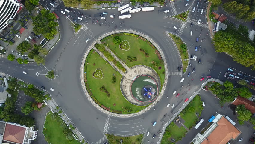 Overhead drone shot of busy intersection in Semarang, Indonesia