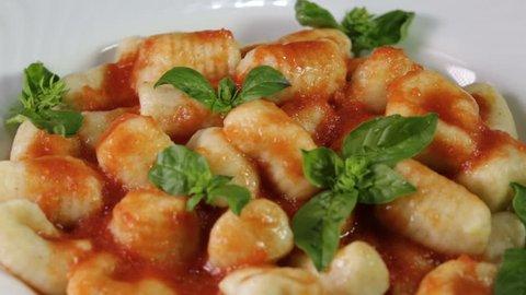 Italian food potato gnocchi in a white dish for a restaurant